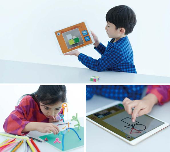 子どもとタブレットの画像
